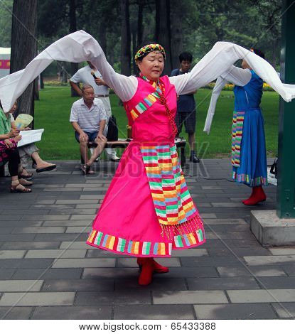 Beijing, China - Jul 17, 2011: Women Are Dancing In National Costumes In Jingshan Park. It S A Popul