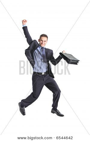 A happy young businessman jumping in the air