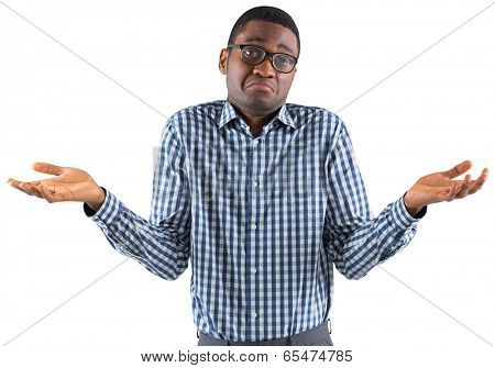Young businessman shrugging shoulders on white background