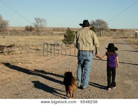 Man and child walking. Holding hands