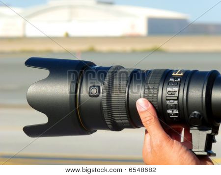 Professional Photographer taking Shot with a Telephone Lens.