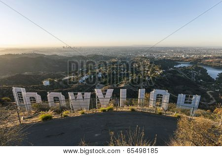 HOLLYWOOD, CALIFORNIA - October, 31:  Sunrise city view from hilltop behind the famous Hollywood sign in Griffith Park, on October 31, 2013 in Los Angeles, California.