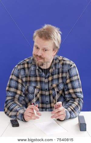 Displeased Business Manager At His Office Desk