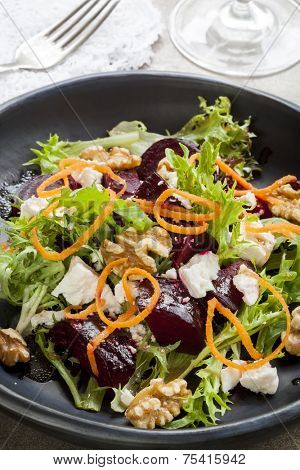 Beetroot salad with feta cheese, walnuts and carrot.