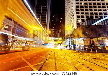 modern urban city traffic trails with cityscape background.timelapse.