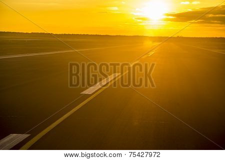 Sunset With Reflections At The Runway