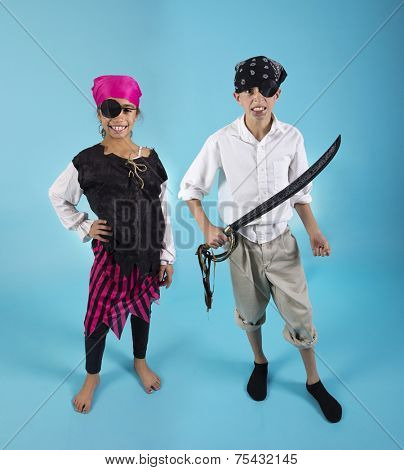 Kids dressed in Halloween Pirate Costumes
