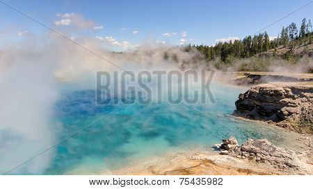 The blue lake in fog, Yellowstone, Excelsior Geyser Crater.