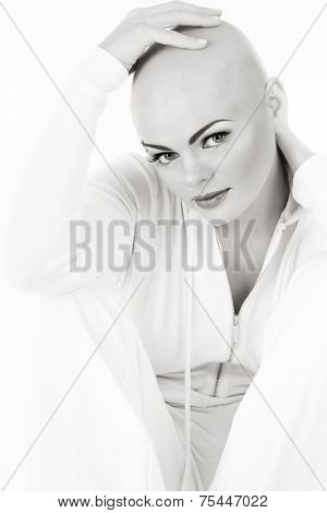 Black and white photo of young beautiful skinhead woman