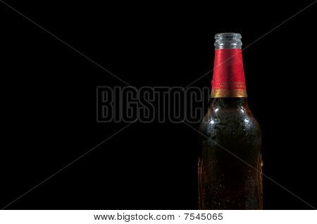 Wet beer on black background
