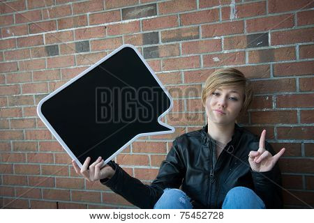 Teen girl at school with sign for your text