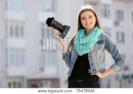 Beautiful young photography take photos outdoors on city street