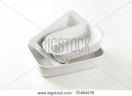 empty baking trays on white background