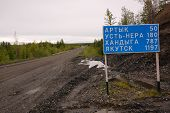 Road sign at gravel road Kolyma to Magadan highway Yakutia outback Russia poster