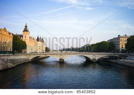 River Seine Paris, France in early morning light, with Conciergerie and bridge.