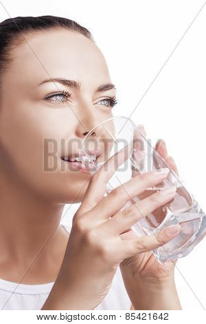 Portrait Of Caucasian Female Drinking Water And Smiling