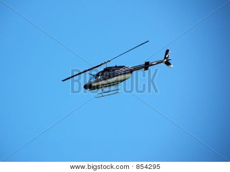 Bell 206 helicopter for private charter poster