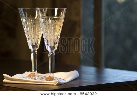 Two Waterford Champagne Glasses with Seashells