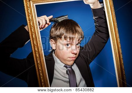 Teenage Boy Posing With Picture Frame