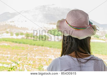 Young Woman In Summer Looking Aimlessly At Vineyard .