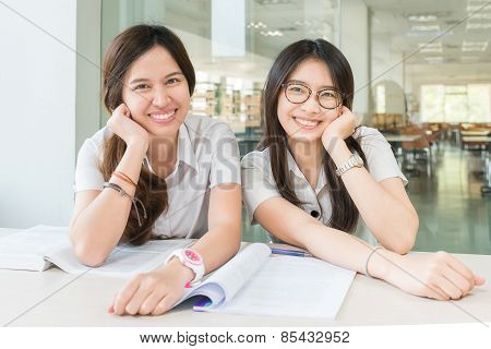 Two Asian Students Studying Together At University