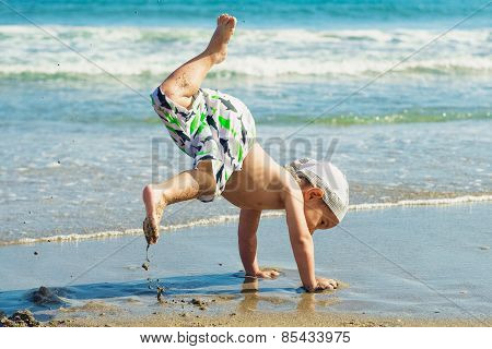 Child dancing on the beach.