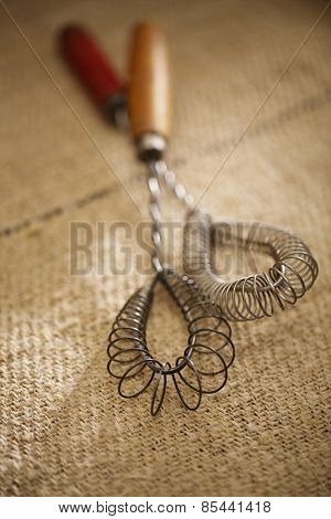 real vintage wooden wire whisk  on old grain sacking linen Completely hand made  handwoven and homespun