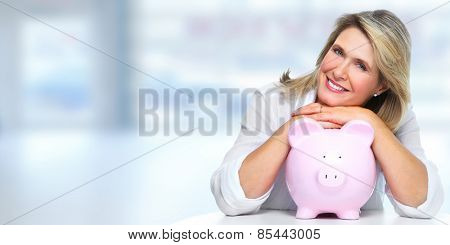 Smiling senior woman with piggy bank. Saving account.