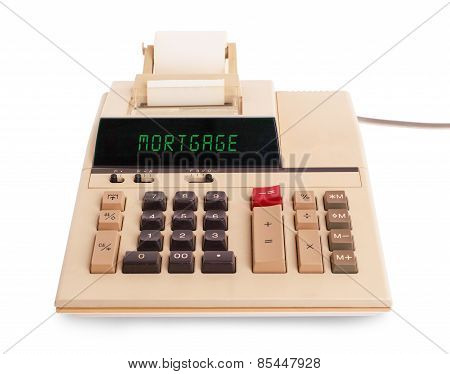 Old calculator showing a text on display - mortgage poster