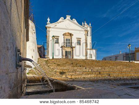 Estoi (Faro district), Algarve, Portugal, Europe - Low angle view of Sao Martinho church in estoi village