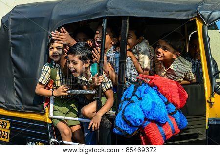 Indian school children going home by a rickshaw