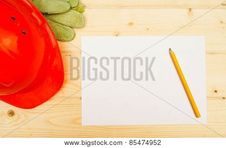 paper with the working tool on wooden background.