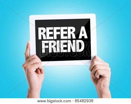 Tablet pc with text Refer a Friend with blue background