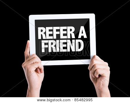 Tablet pc with text Refer a Friend isolated on black background