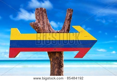 Colombia Flag sign with a beach on background  poster