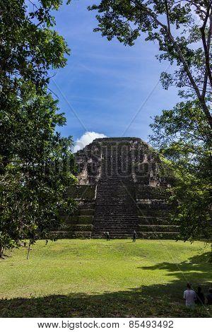 Young Women Climbing Mayan Ruins At Tikal, National Park. Traveling Guatemala, Central America.