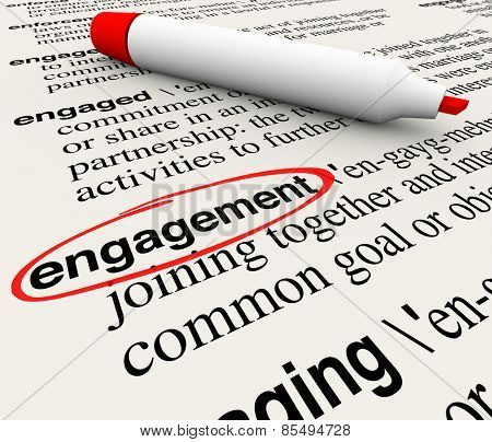Engagement word circled in a dictionary definition to illustrate meaning of the word in business attracting customers with involvement and participation