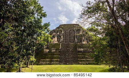 Young Women Climbing Mayan Ruins At Tikal, National Park. Traveling Guatemala, Central America.