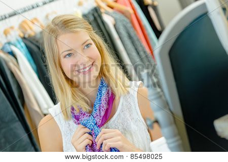 Trying on a scarf in a shop