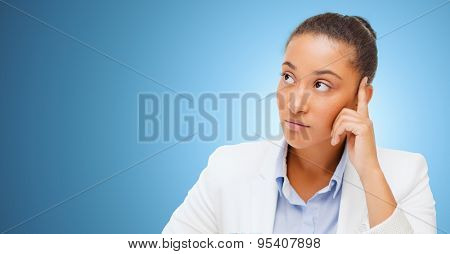 business and people concept - african american businesswoman looking up and thinking over blue background