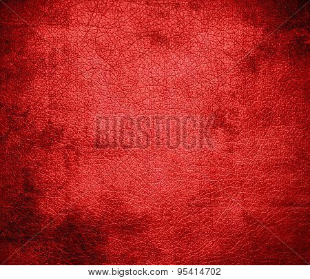 Grunge background of coral red leather texture