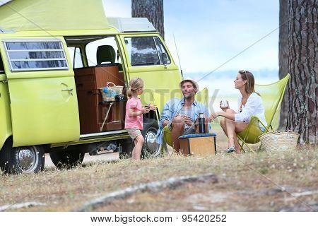 happy family relaxing by camper van in summer poster