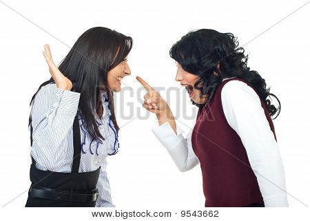 Two women having a funny confrontation and accusatory and laughing together isolated on white background poster