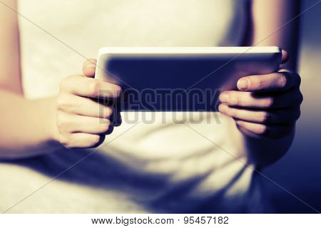 Female hands holding a digital tablet computer