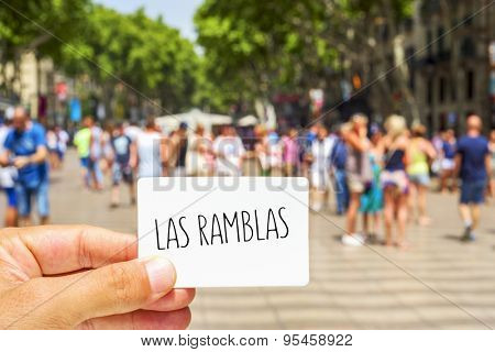 closeup of the hand of a young man showing a signboard with the text Las Ramblas, at the famous Ramblas in Barcelona, Spain poster