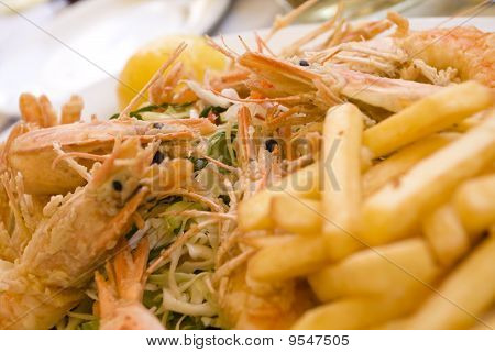Detail of a fresh shrimps plate in a traditional greek restaurant. poster