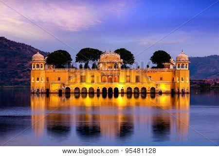 Rajasthan landmark - Jal Mahal (Water Palace) on Man Sagar Lake in the evening in twilight.  Jaipur, Rajasthan, India poster