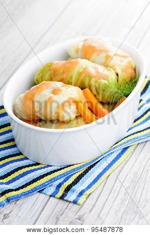 stuffed cabbage rolls with rice and meat in tomato sauce.