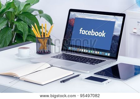 Facebook New Logo On The Apple Macbook Pro Screen That Is On Office Desk