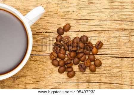 Expresso And Coffee Beans On Old Wooden Table
